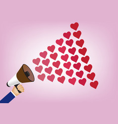 hand holding megaphone to speech into heart vector image