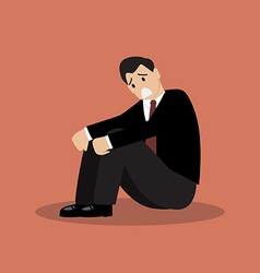 Desperate businessman sitting alone vector image