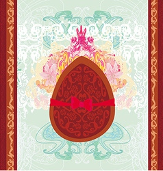 chocolate egg with red bow vector image