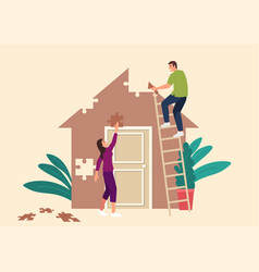 couple building a house made from puzzle pieces vector image