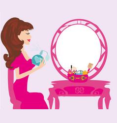 young woman spraying perfume on herself vector image