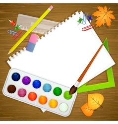 School stationery and empty paper on blue vector image