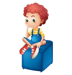 A young boy sitting above blue chair vector