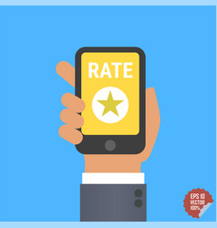 Hand holding smartphone with rate button star vector