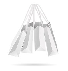 Hanging white paper bags vector image