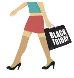 Woman walking with black friday shopping bag vector