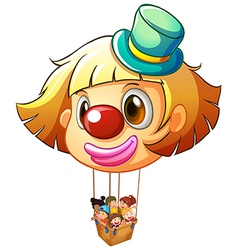 A big clown balloon with a basket full of happy vector image