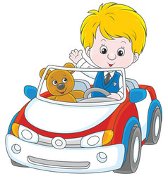 Little boy in a toy car vector