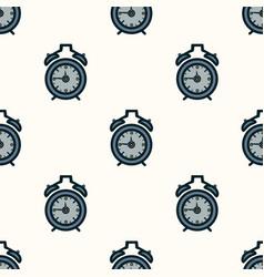 seamless pattern of alarm clocks on the vector image