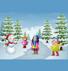 Happy kids playing with a snowman in winter vector