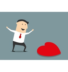 Happy businessman finding a love heart vector image
