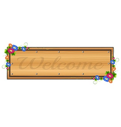 A wooden signboard with a welcome label vector image vector image