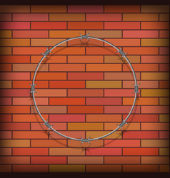 barbed wire circle on red brick background vector image