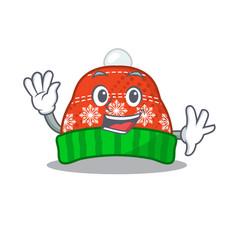 Waving winter hat in mascot shape vector