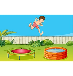A boy on a trampoline vector image