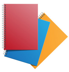 notebooks red yellow blue on white vector image