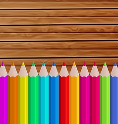 Palette pencils on wooden background vector image