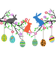 Rabbits on easter eggs tree vector