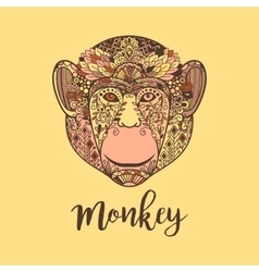 Monkey head with colorful ethnic motifs vector
