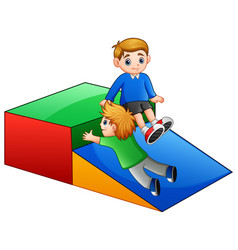 children playing slide in playground vector image
