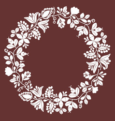 white floral laurel wreath frame on dark brown vector image