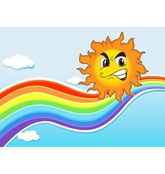 A sky with rainbow and an angry sun vector
