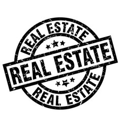 Real estate round grunge black stamp vector