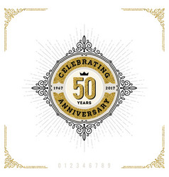 Vintage anniversary flourishes logo emblem vector