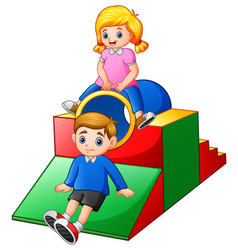 boy and girl playing in the playground vector image