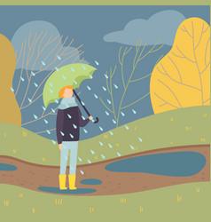 boy walking in rain under umbrella teen boy vector image