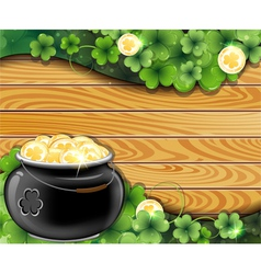 Pot of gold on wooden backgroun vector image