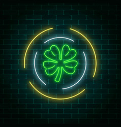 Neon glowing clover leaf sign in circle frames on vector