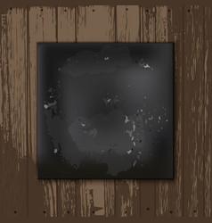 Square blackboard at white wooden backdrop vector