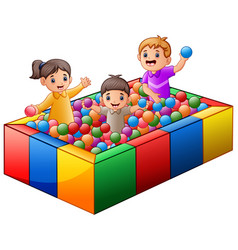 children playing on colorful balls pool vector image