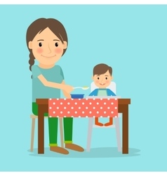 Mother Feeding Her Baby Boy vector image