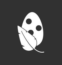 White icon on black background egg and leaf vector