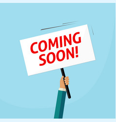 coming soon placard banner poster on person vector image