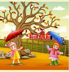 happy girl holding umbrella at farm landscape vector image