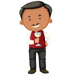 Winemaker holding glass of white wine vector