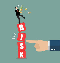 businessman standing on shaky risk blocks by hand vector image vector image