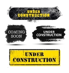set of grunge textured Under Construction vector image