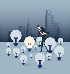 businessman look the only bright light bulb vector image