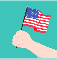 human hand holding flag of usa country isolated on vector image