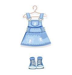 denim dress on a hanger and denim sneakers vector image
