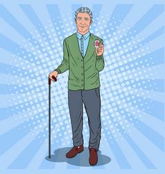 Pop art senior man holding pills health care vector