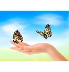 Hand holding butterflies vector