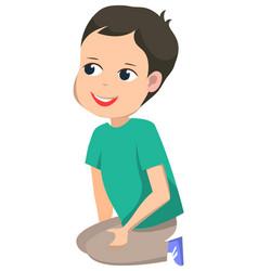 elementary school kid sitting on floor vector image