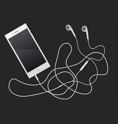 Phone with earphones lying on a table vector