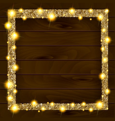 Square gold frame on a wooden background vector