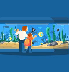 dad with son in oceanarium vector image